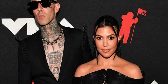 Travis Barker and Kourtney Kardashian in matching black styles.