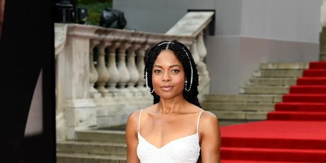 Naomie Harris attends the 'No Time To Die' premiere in Michael Kors.