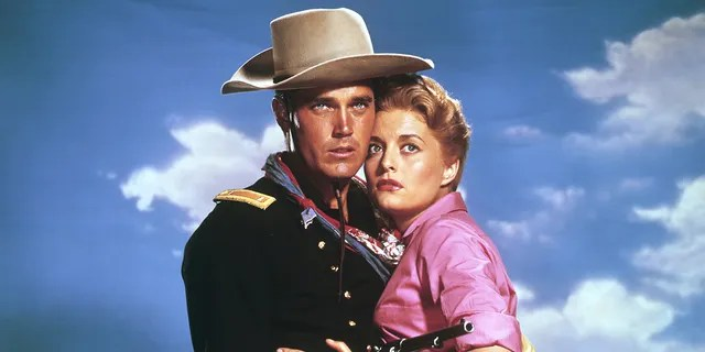 """American actors Jeffrey Hunter and Constance Towers on the set of """"Sergeant Rutledge"""" directed by John Ford."""