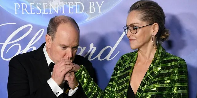 HSH Prince Albert II of Monaco (L) and Sharon Stone arrive in 2020 Hollywood for the Global Ocean Gala honoring HSH Prince Albert II of Monaco at Palazzo d'Amore on February 06, 2020 in Beverly Hills, California.