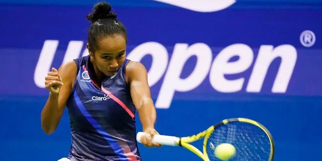 Leylah Fernandez, of Canada, returns a shot to Naomi Osaka, of Japan, during the third round of the U.S. Open tennis championships, Friday, Sept. 3, 2021, in New York City. (Associated Press)