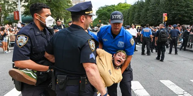 Black Lives Matter protesters are arrested outside The Met Gala at The Metropolitan Museum of Art on September 13, 2021 in New York City.