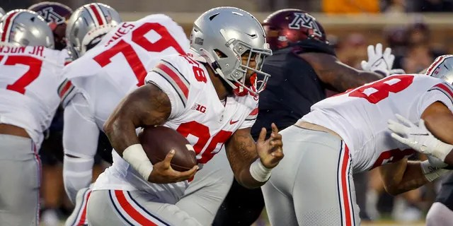 Ohio State running back Miyan Williams (28) rushes for a touchdown against Minnesota in the first quarter of an NCAA college football game Thursday, Sept. 2, 2021, in Minneapolis. (AP Photo/Bruce Kluckhohn)