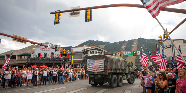 Community members honor Marine Lance Cpl.  Riley McCollum during the procession on Friday, September 10, 2021.