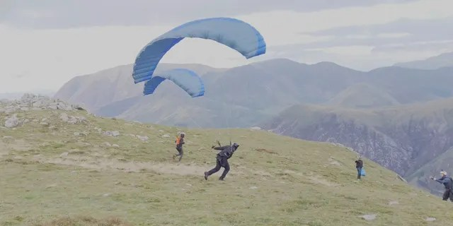 Cruise parachuted off a cliff. He was practicing a stunt for his upcoming movie.