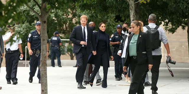 The Sussexes donned dark outfits for the occasion.