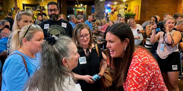 Former White House press secretary Sarah Sanders greets supporters at an event for her campaign for governor at a Colton's Steak House in Cabot, Arkansas, Friday, Sept. 10, 2021. (Associated Press)