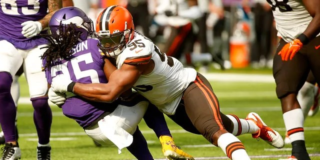 Minnesota Vikings running back Alexander Mattison (25) is tackled by Cleveland Browns defensive end Myles Garrett (95) during the second half of an NFL football game, Sunday, Oct. 3, 2021, in Minneapolis.