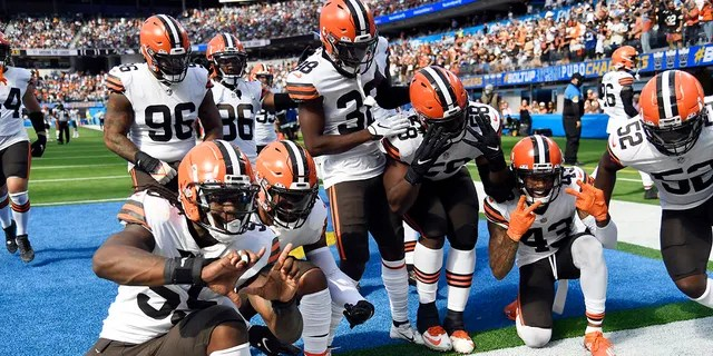 Cleveland Browns players celebrate after a fumble recovery on a kickoff during the first half of an NFL football game against the Los Angeles Chargers Sunday, Oct. 10, 2021, in Inglewood, California.