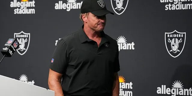 Las Vegas Raiders head coach Jon Gruden leaves after speaking during a news conference after an NFL football game against the Chicago Bears in Las Vegas, in this Sunday, Oct. 10, 2021, file photo. Jon Gruden is out as coach of the Las Vegas Raiders after emails he sent before being hired in 2018 contained racist, homophobic and misogynistic comments.