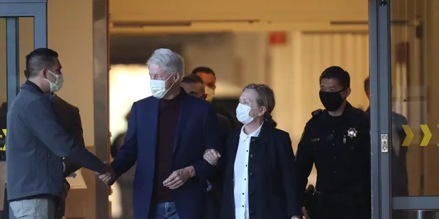 ORANGE CA OCTOBER 17, 2021 - Former President Bill Clinton, standing with his wife, Hillary, was discharged from UC Irvine Medical Center Sunday morning. (Allen J. Schaben / Los Angeles Times via Getty Images)