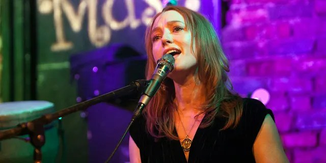 Singer/pianist Alicia Witt performs at the Evening Museum on December 17, 2016 in Charlotte, North Carolina.