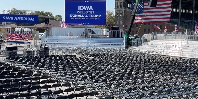 Workers at the site of former President Trump's Iowa rally put the finishing touches on the venue at the Iowa State Fairgrounds on the eve of the event, on Oct. 8, 2021 in Des Moines, Iowa
