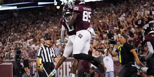 Texas A&M tight end Jalen Wydermyer (85) celebrates with wide receiver Ainias Smith (0) after scoring a touchdown agent Alabama during the first half of an NCAA college football game Saturday, Oct. 9, 2021, in College Station, Texas.
