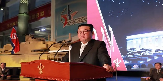 North Korean leader Kim Jong Un speaks during an exhibition of weapons systems in Pyongyang, North Korea, on Monday. (Korean Central News Agency/Korea News Service via AP)