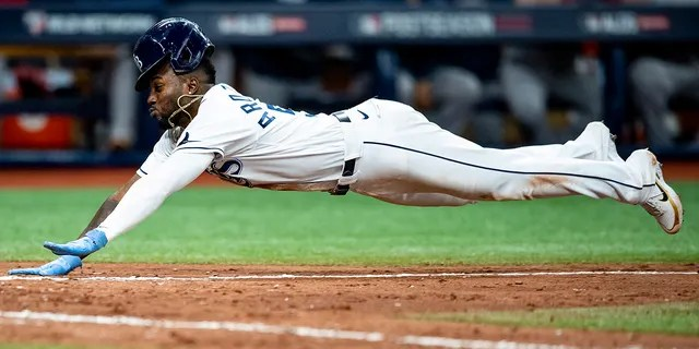Randy Arozarena #56 of the Tampa Bay Rays slides as he steals home plate during the seventh inning of game one of the 2021 American League Division Series against the Boston Red Sox at Tropicana Field on October 7, 2021 in St Petersburg, Florida.