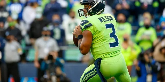 Seattle Seahawks quarterback Russell Wilson looks to pass against the Los Angeles Rams during the first quarter at Lumen Field.