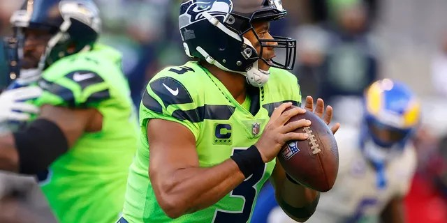 Seattle Seahawks quarterback Russell Wilson (3) passes against the Los Angeles Rams during the first half of an NFL football game, Thursday, Oct. 7, 2021, in Seattle.