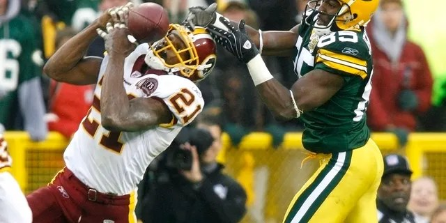 Washington Redskins safety Sean Taylor (21) intercepts a pass intended for Green Bay Packers wide receiver Greg Jennings (85) from quarterback Brett Favre in the fourth quarter of their NFL football game at Lambeau Field Green Bay, Wisconsin Oct. 14, 2007. Favre, with two interceptions in the Packers win over the Redskins, set a new NFL career record for interceptions by a quarterback.