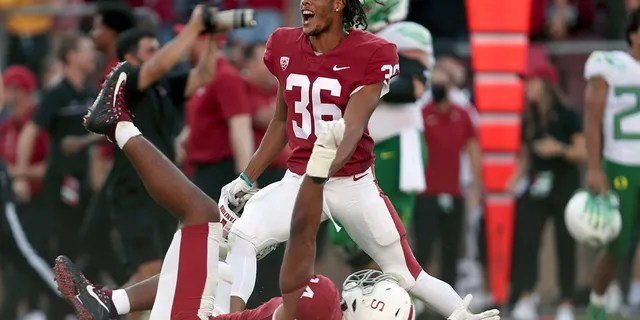 Stanfords' Jaden Slocum (36) and Jacob Mangum-Farrar (14) celebrate after defeating Oregon in an NCAA college football game in Stanford, Calif., Saturday, Oct. 2, 2021.
