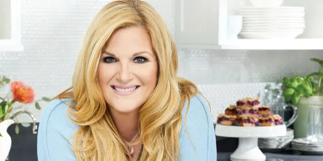 This cover image released by Mariner Books shows 'Trisha's Kitchen: Easy Comfort Food for Friends and Family' by Trisha Yearwood.