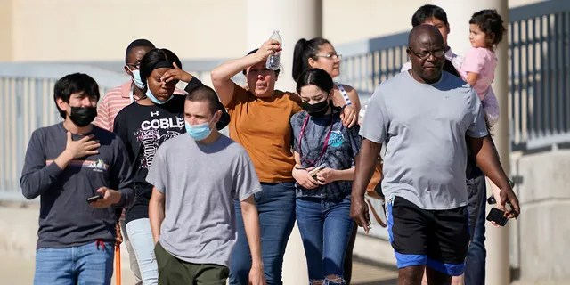 Families depart the Mansfield ISD Center For The Performing Arts Center where families were reunited with Timberview High School Students on Wednesday in Mansfield, Texas. (AP Photo/Tony Gutierrez)