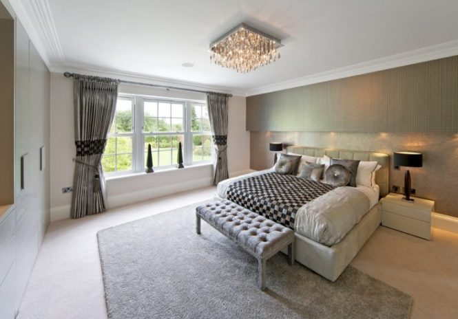 Gray Bedroom With Crystal Chandelier