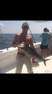 Austin and his Amberjack caught while deep sea fishing on the Big Adventure