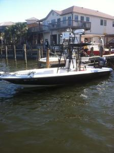 Shearwater inshore fishing charters aboard a 24' Center Console fishing boat with a tall tower