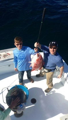 Anglers with a Big Red Snapper caught deep sea fishing along the AL gulf coast spring 2015