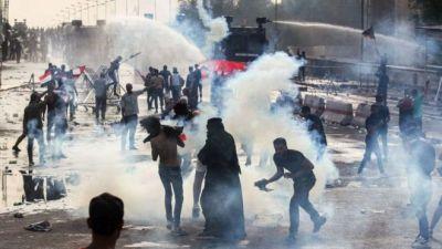 """محافظ كربلاء: المتظاهرون حملوا قنبلة محرمة دوليًّا ومقاطع القمع """"مفبركة"""""""