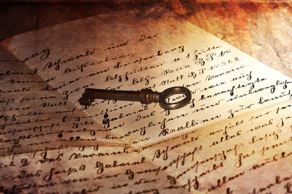 old key on an antique hand written letter