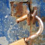 Blue wooden door with a open lock