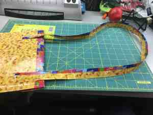 Image of attaching duct tape strap to a duct tape iPad case.