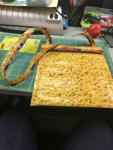 Image of an iPad case with strap made from duct tape