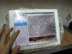 iPad in a clear shower cap