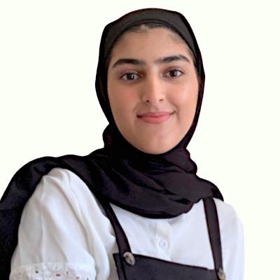 Emaan Sami Khan, a young Irish woman wearing a hijab, smiling.