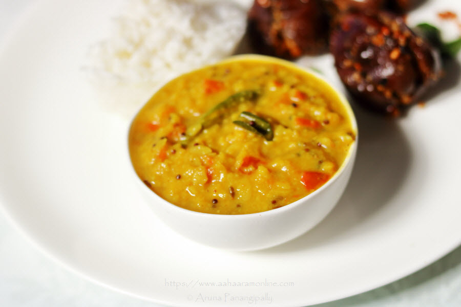 Tomato Pappu, Andhra-style Tomato Dal, served with rice and stuffed brinjals
