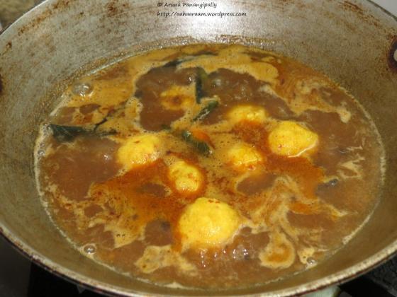 Paruppu Urundai Kuzhambu - Add the Balls to the Boiling Kuzhambu