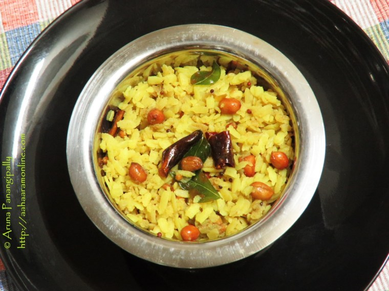 Atukula Pulihora is the traditional tamarind rice with beaten rice or poha