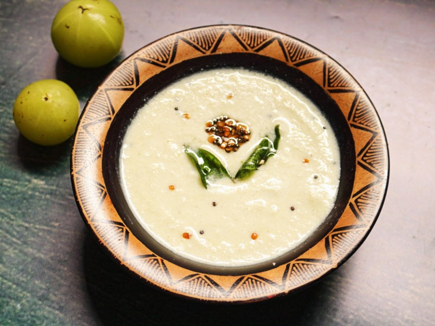 Usirikaya Perugu Pachadi | Amla Raita served in a wooden bowl on a blue background