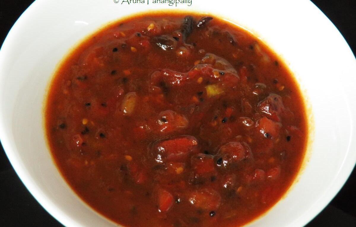 Bengali Tomato Khejur Aamshottor Chutney   Bengali Style Tomato, Date, and Mango Leather Chutney