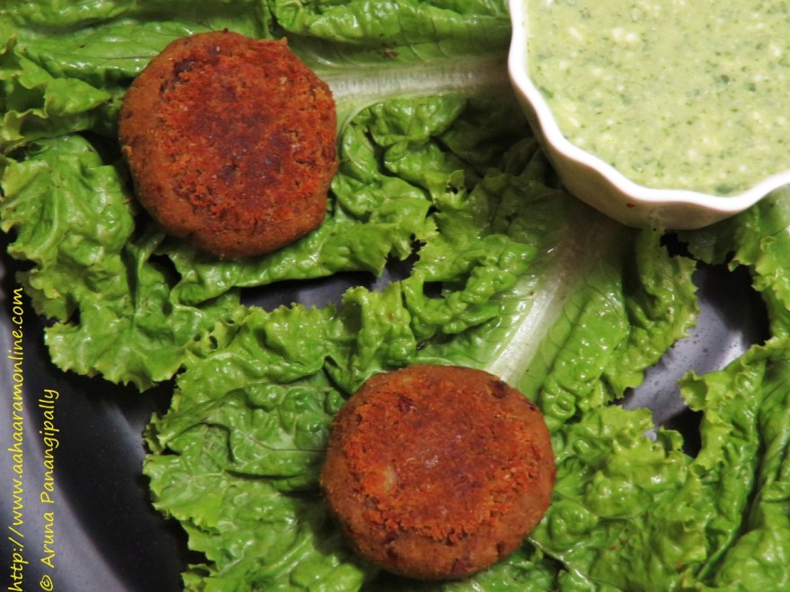 Vegetarian Galouti Kebab with Rajma and Soya served ona bed of lettuce and mint chutney on the side