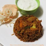 Ulava Charu Biryani (Horse Gram Biryani) served with Dahi and Papad