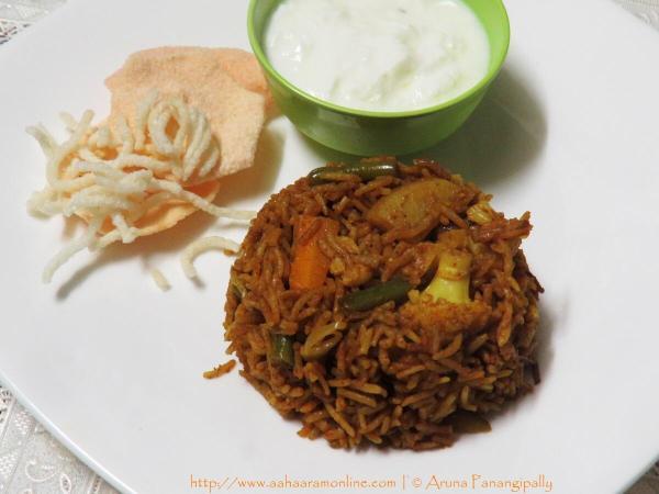 Ulava Charu Biryani (Horse Gram Biryani) served with Dahi and Papad