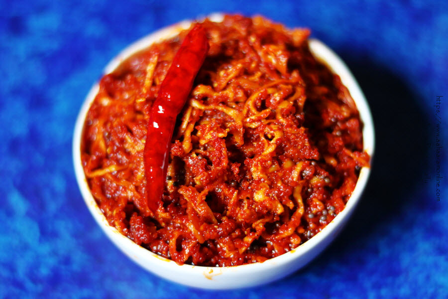 Mamidi Thokku or Mamidikaya Turumu Pachadi is a mango pickle made with grated and sun-dried unripe mangoes.