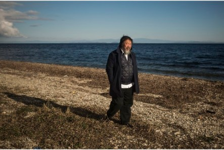Chinese activist and artist Ai Weiwei walks on a beach next to the town of Mytilini, on the Greek island of Lesbos, Friday, Jan. 01, 2016. The Chinese artist visited the island of Lesbos is solidarity with refugees and migrants who continue to arrive on a daily basis hoping to make their way into Europe. (AP Photo/Santi Palacios)