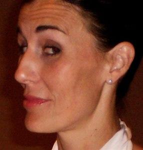 Close-up of Elizabeth Aselage eyebrows raised