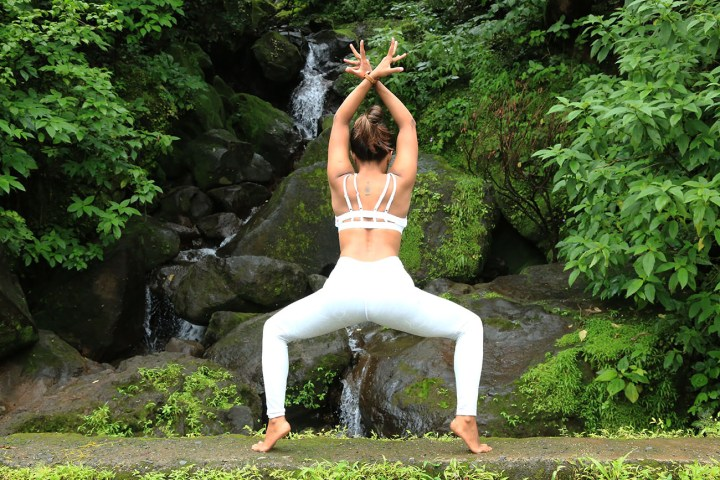 A Girl performing Goddess Pose as a part of her fitness routine