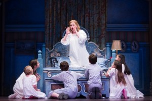 Billie Wildrick as Maria, with the Von Trapp children in the Sound of Music, now playing at the Ordway. (Photo by Rich Ryan Photography)